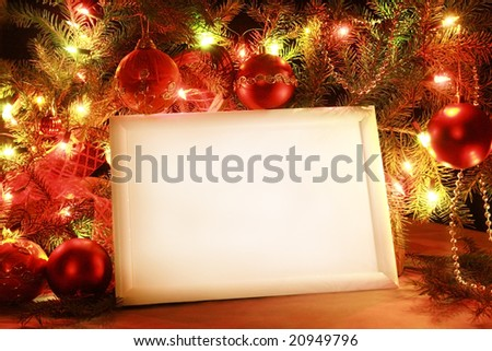 Colorful abstract background with Christmas lights and white frame. - stock photo
