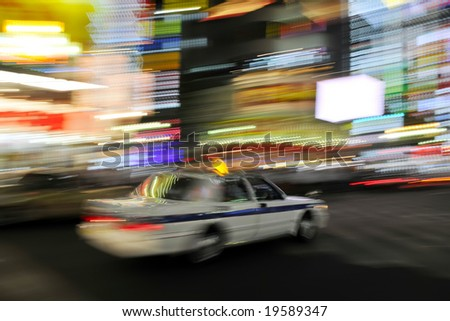 Colorful abstract panning shot of taxi cab in Tokyo, Japan. - stock photo