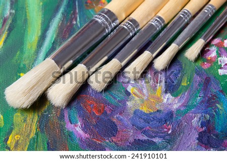 colorful acrylic paint and artist paint brushes set