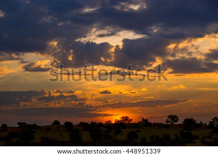 Colorful african sunset in Kalahari desert, Namibia. - stock photo