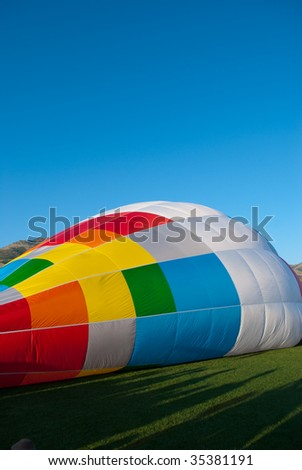 Colorful air balloon inflating
