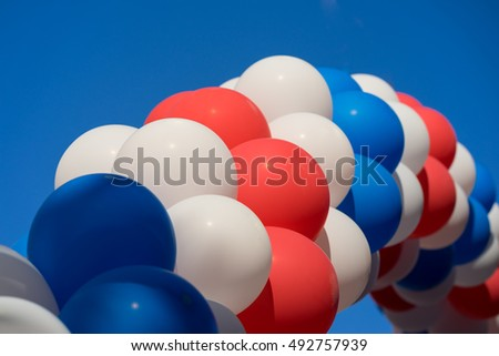 Colorful air balloons on blue sky background
