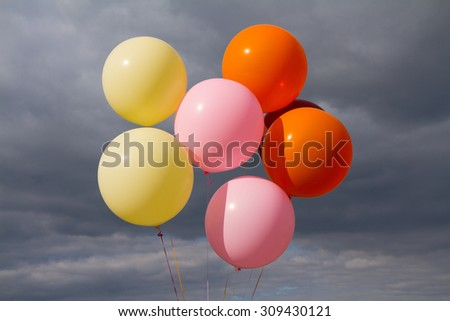 Colorful air balloons over stormy sky background. - stock photo