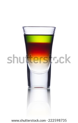 Colorful alcoholic cocktail in a shot glass - stock photo