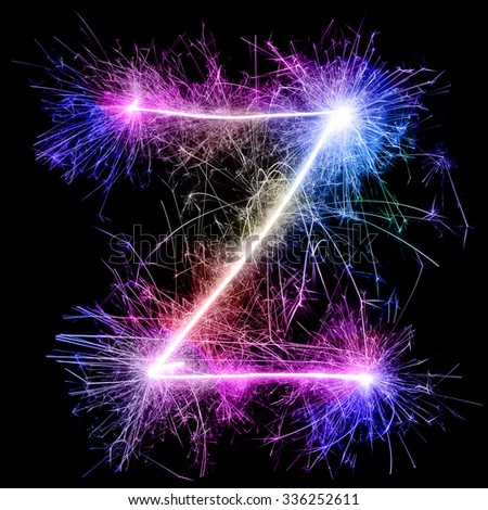 colorful alphabet A-Z from sparkler on black background - stock photo