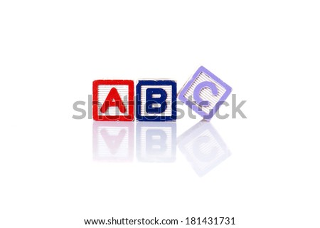 Colorful alphabet blocks of ABC word with reflection over white background - stock photo
