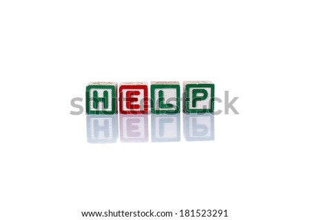 Colorful alphabet blocks of HELP word with reflection over white background