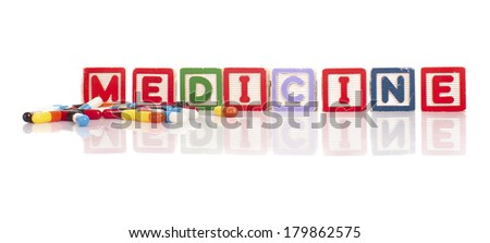 Colorful alphabet blocks of medical word with reflection.
