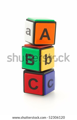 Colorful alphabet blocks stacked on white background