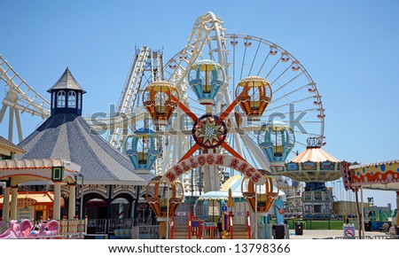 Colorful amusement park rides - stock photo