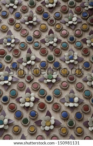 Colorful ancient tiles texture on wall in Wat phra kaew,bangkok Thailand
