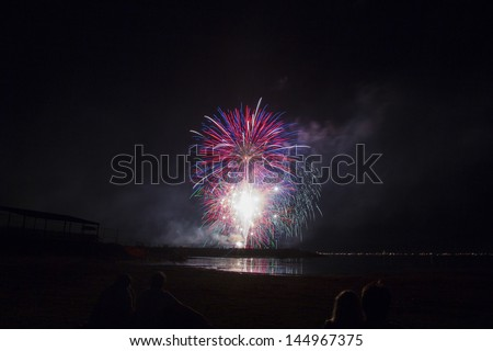 Colorful and Artistic Fireworks Display over Big Bear Lake California July 4, 2013 - stock photo