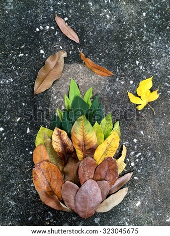 Colorful and bright background made of fallen autumn leaves. on stone background - stock photo