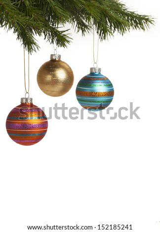 Colorful and festive baubles hanging on Christmas tree for holiday season. With copy space. - stock photo