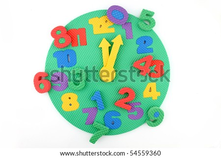 Colorful and round toy clock with time disorder - stock photo
