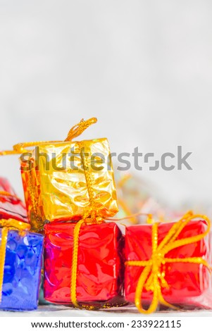 Colorful and striped boxes with gifts tied bow