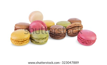 Colorful and tasty French Macarons on isolated white background