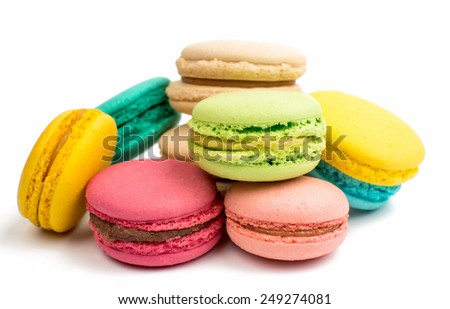 Colorful and tasty French Macarons on white background - stock photo