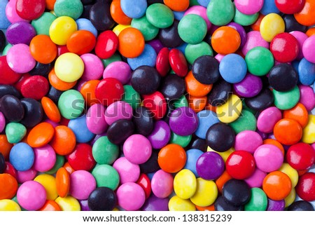 Colorful and vibrant candy arranged randomly in a background.