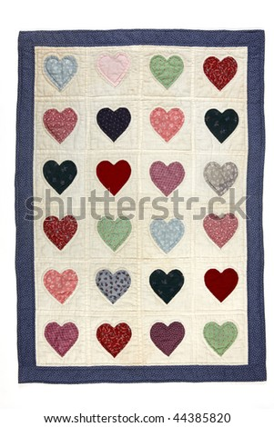 Colorful antique quilt blanket with a heart motif - stock photo