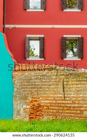 Colorful apartment building with nice view in Burano, Venice, Italy. - stock photo