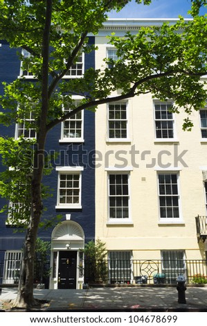 Colorful apartment town homes from the village in Manhattan, New York. - stock photo