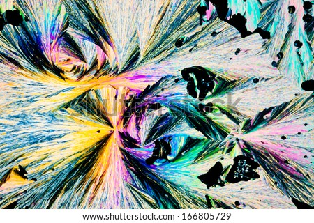Colorful appearance of crystals of benzoic acid, a food preserving additive, in polarized light. - stock photo