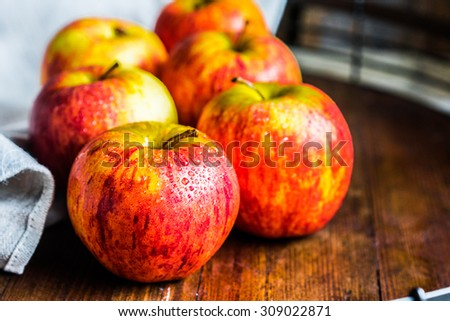 Colorful apples on wooden background