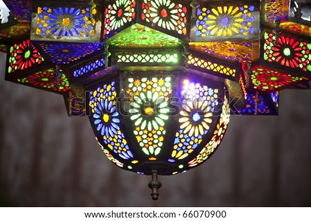 Colorful arabian lamp of metal and glass with flower motive. Copy space. - stock photo