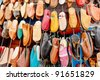 Colorful arabic shoes alignment in a shop - stock photo