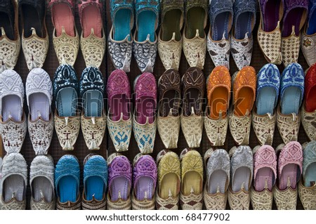 Colorful Arabic shoes display in shop - stock photo