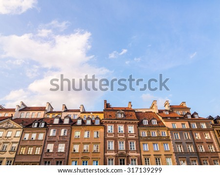 Colorful architecture on the Warsaw's Old Town Market Place on a late summer afternoon. Wide angle, horizontal orientation. - stock photo