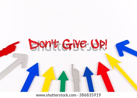 Colorful Arrows Showing to Center with a phrase Don't Give Up! - stock photo