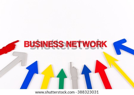 Colorful arrows showing to center with a word BUSINESS NETWORK - stock photo