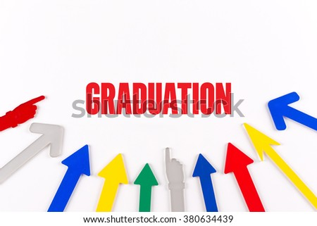 Colorful Arrows Showing to Center with a word GRADUATION - stock photo