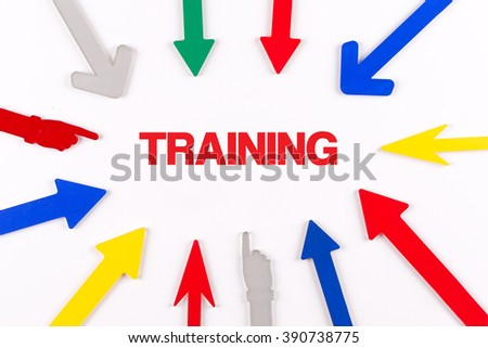 Colorful arrows showing to center with a word TRAINING - stock photo