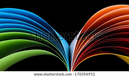 Colorful art paper on black background - stock photo