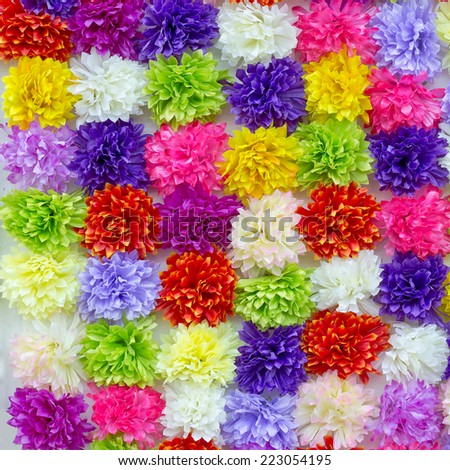 Colorful artificial flowers background - stock photo