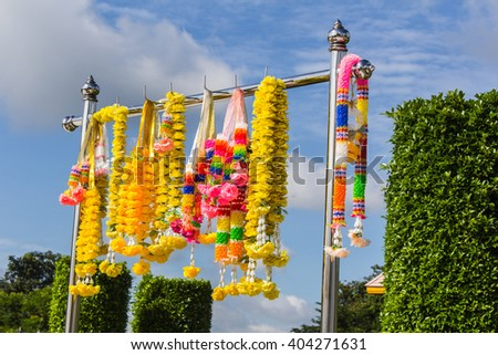 Colorful artificial garland for place of worship - stock photo