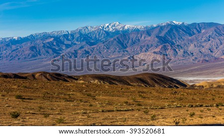 Colorful artist's drive in Death Valley. A part of one way scenic drive. The shapes, colors, sizes and shadows change with every minute along the drive. Artist's Drive, Death Valley National Park - stock photo