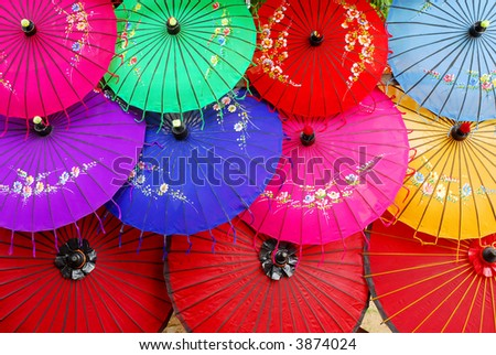 colorful asian umbrella's decorated with flowers - stock photo