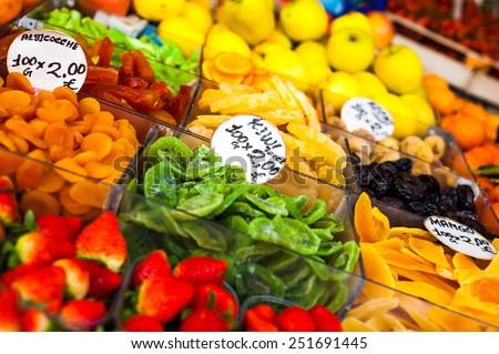 Colorful assorted candied sugary sweet real fruits like strawberries kiwi orange peach grape apple on the market - stock photo