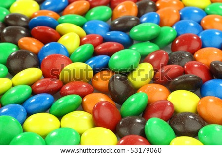 colorful assorted  sweets with a shiny surface background
