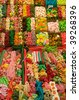 colorful assortment of candy at boqueria market in barcelona - stock photo