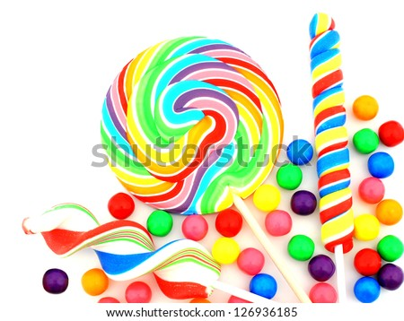 Colorful assortment of candy over white - stock photo