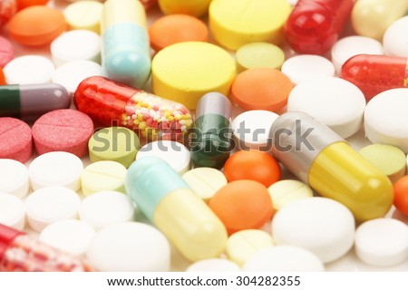Colorful assortment of tablets and pills background