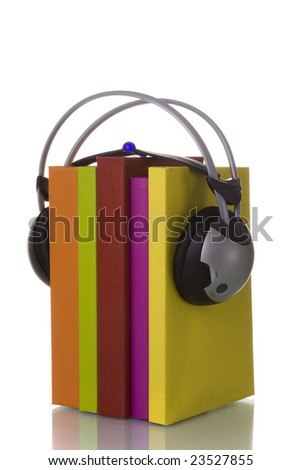 colorful audiobook concept with headphones and books (isolated on white) - stock photo