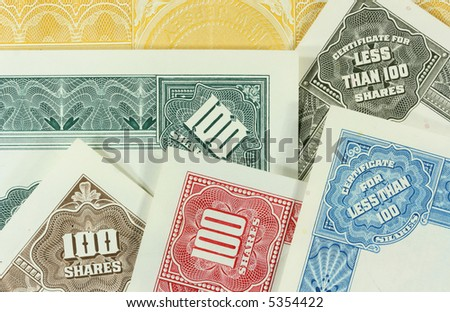 Colorful, authentic, old share certificates of American corporations. Vintage scripophily collectibles. - stock photo