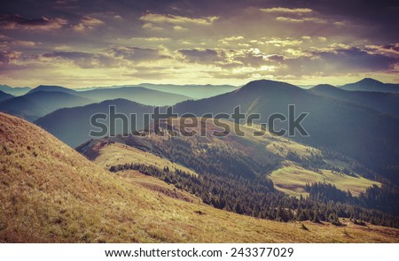 Colorful autumn landscape in mountains. Retro style. - stock photo