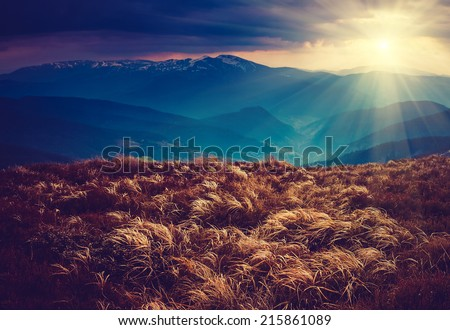 Colorful autumn landscape in the mountains.Dramatic overcast sky.  Filtered image:cross processed vintage effect.  - stock photo